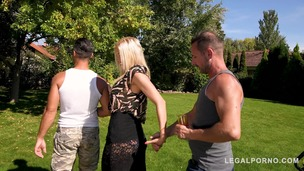 Two big hard dicks make blonde busty glamour babe Kitana Lure suck for cum GP244 screenshot